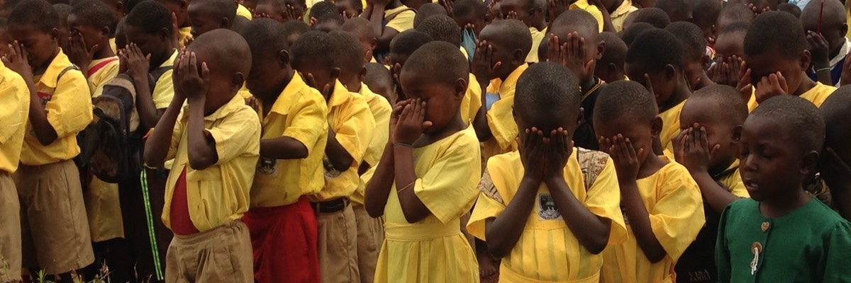 Katakala Church of Uganda Primary school praying with St Mary's Old Basing