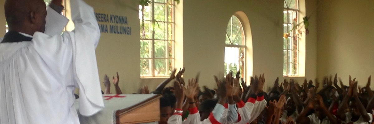 St Apolo's, Katakala, Uganda: prayer led by choir